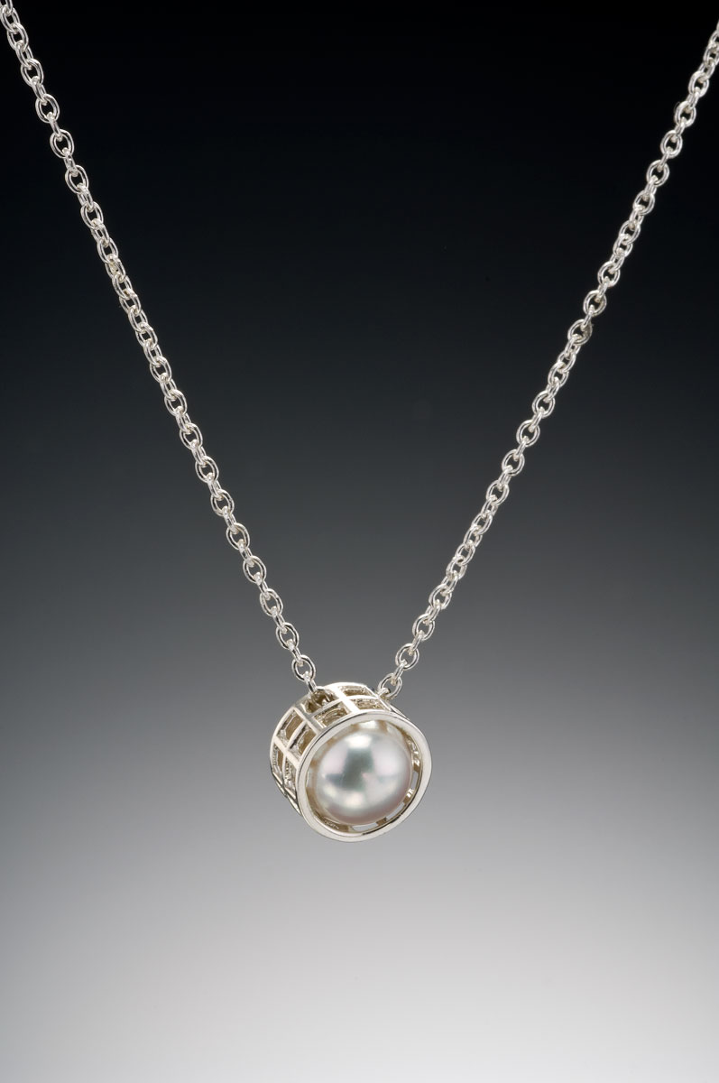 Mesh silver caged pearl pendant