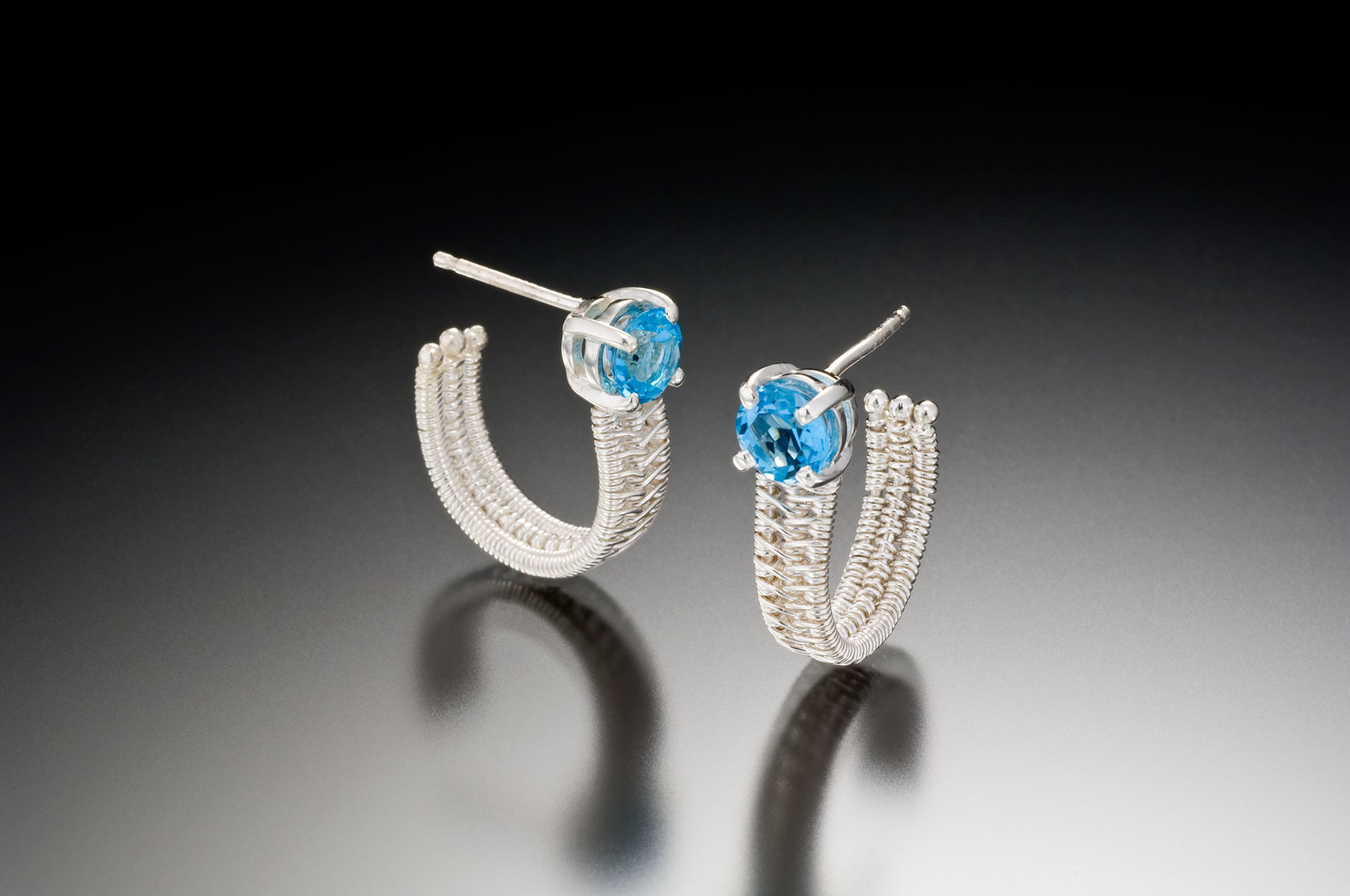 Sigma silver hoops blue topaz