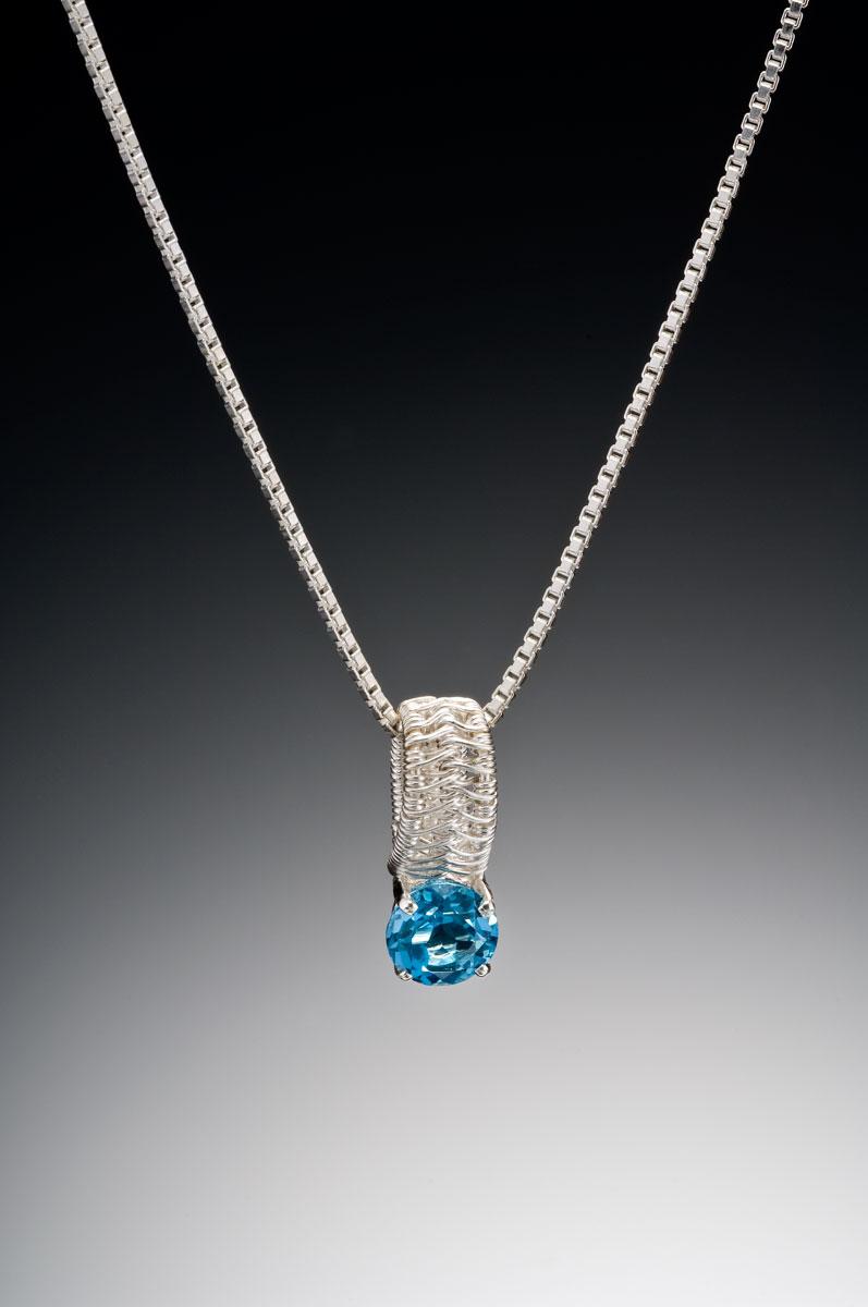 Sigma silver pendant blue topaz