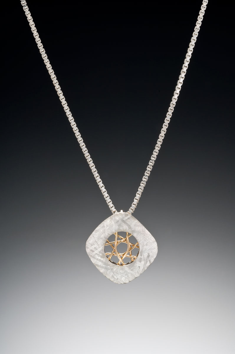 Spyro small silver cushion pendant