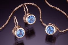 Caged facet blue topaz